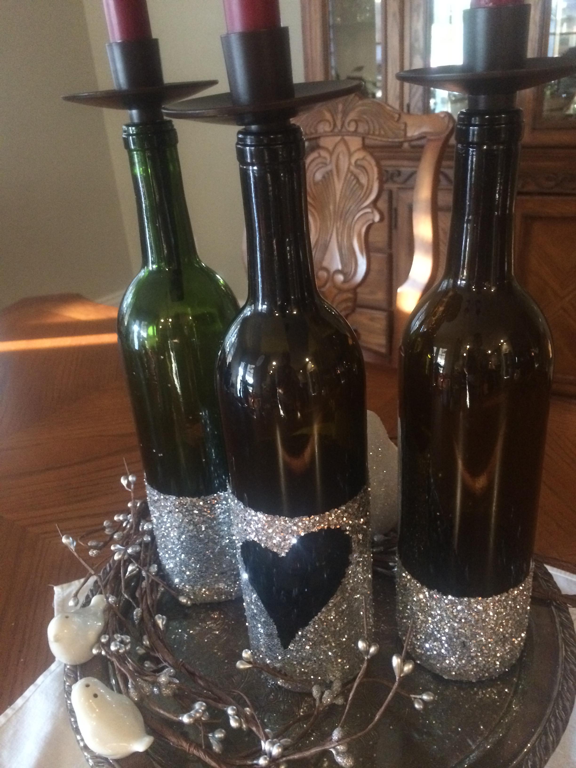Diy glitter dipped wine bottle centerpiece originally for Homemade wine bottle centerpieces